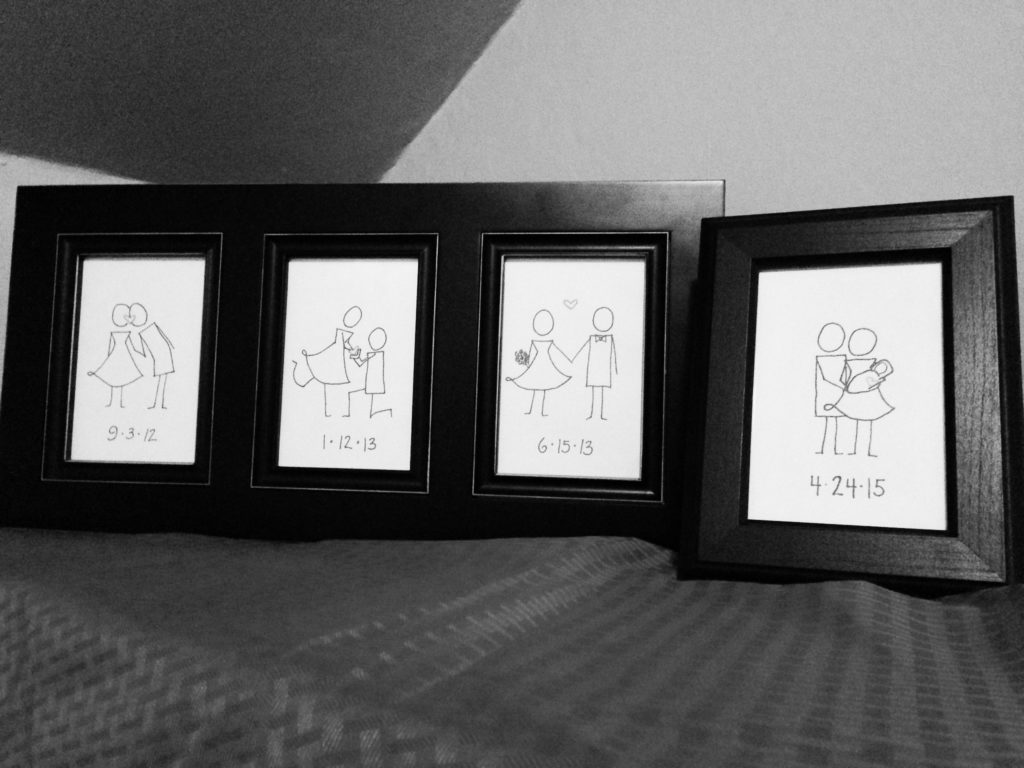 photos of artwork in frames on a table